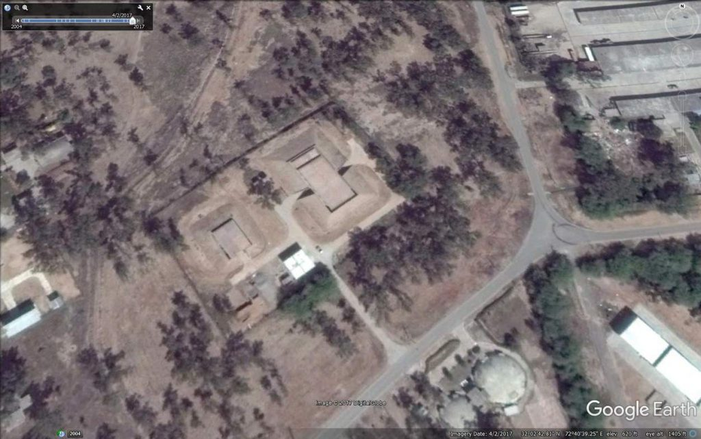 Heavily fortified bunkers. Possible weapon storage