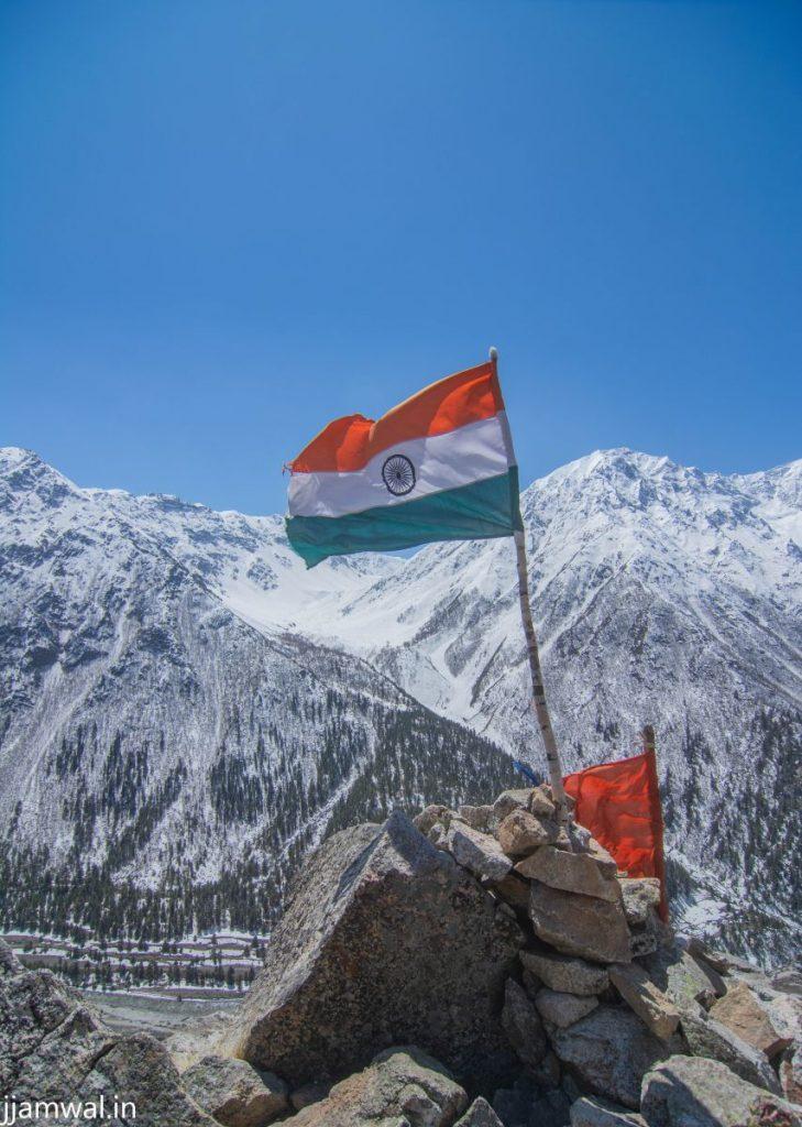 Indian flag on mountain ridge in Chitkul